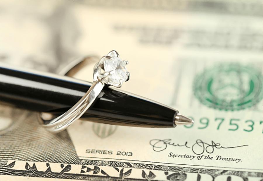 ring on pen over cash