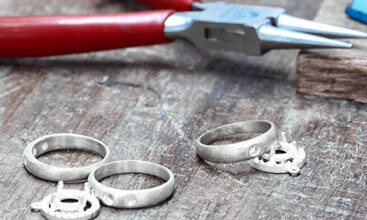 rings on workbench with pliars