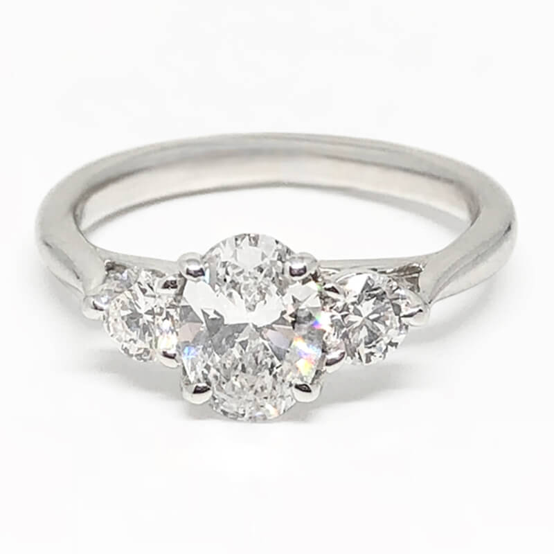 Oval Diamond Ring with 2 Side Round Diamonds