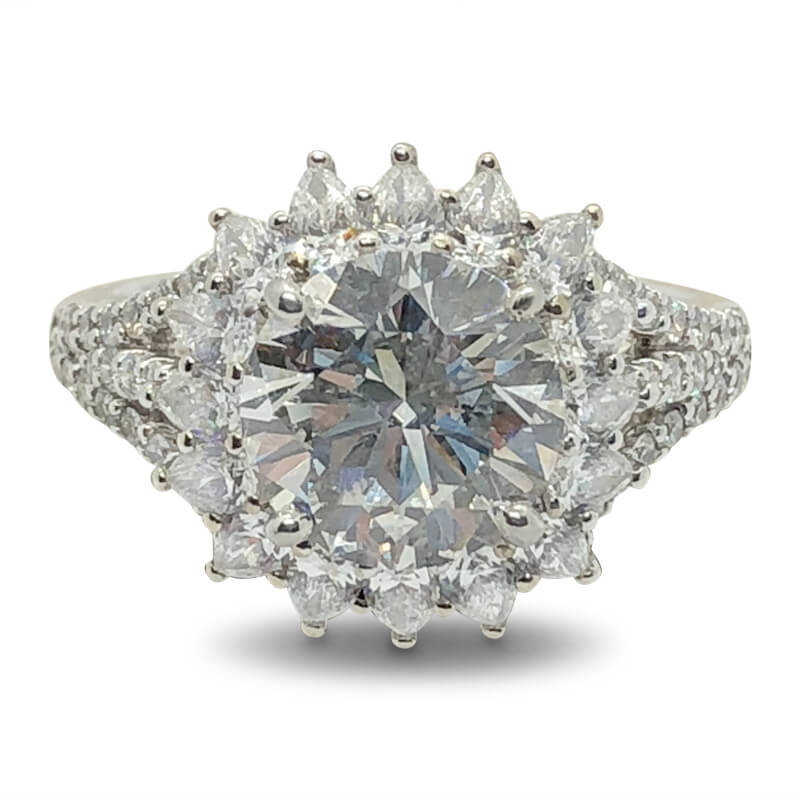 Platinum Round Diamond Ring with Pear Diamond Halo