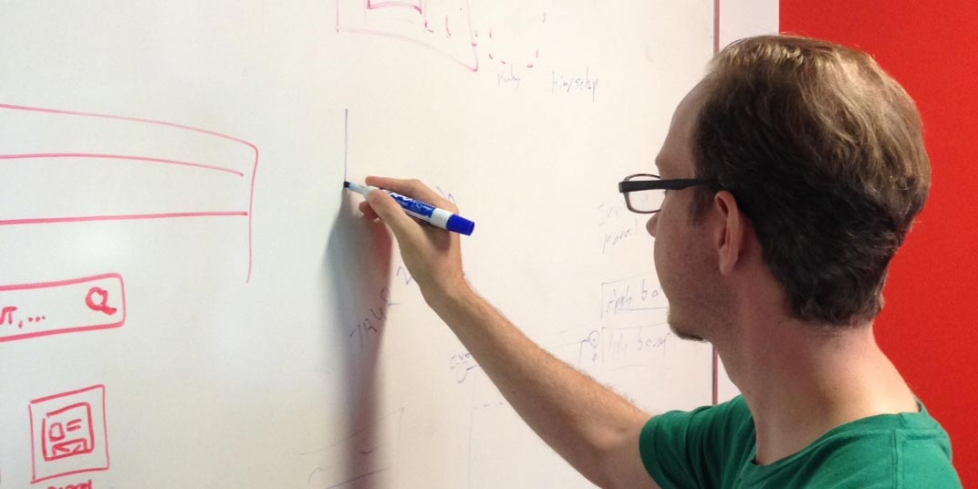 photo of someone using a whiteboard