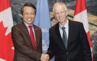 High Representative for Disarmament Affairs Kim and Minister of Foreign Affairs of Canada Dion shake hands