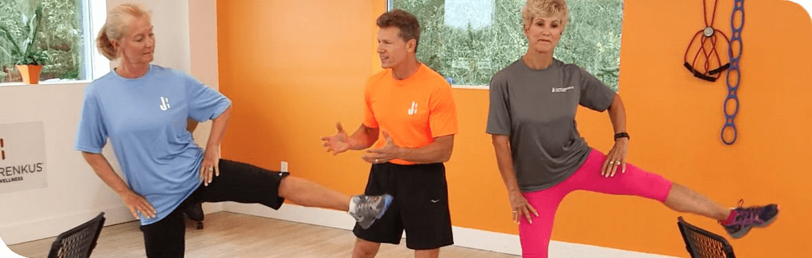 jaime brenkus instructing two women to exercise
