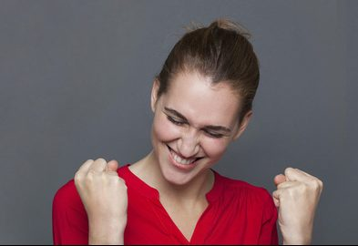 Woman celebrating by pumping fists