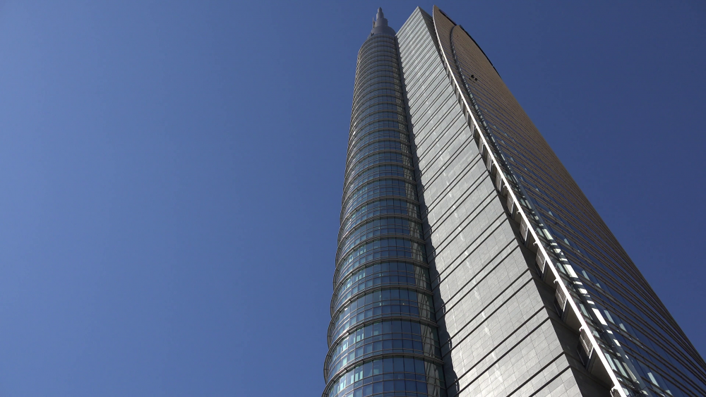 4k-modern-tall-tower-glass-facade-blue-sky-skyscraper-office-building-futuristic-_editorial-footage_rkgwx6d__F0000.png
