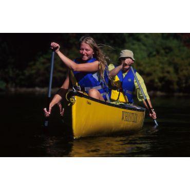 girl in front of canoe