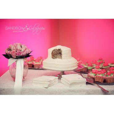 pink lighting behind cake