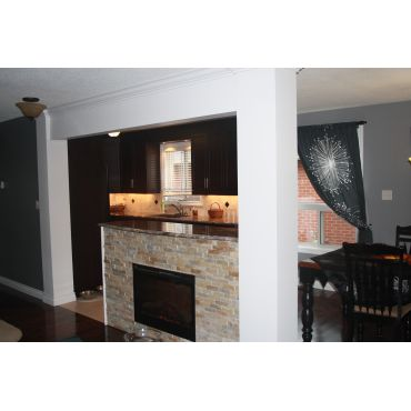 Chocolate cabinets, granite & fireplace