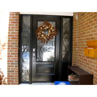 Wrought Iron glass design in a steel doo