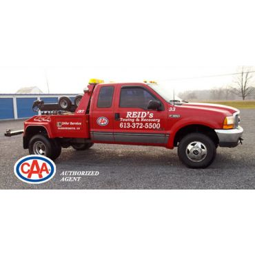 Reid's Towing & Recovery Service logo