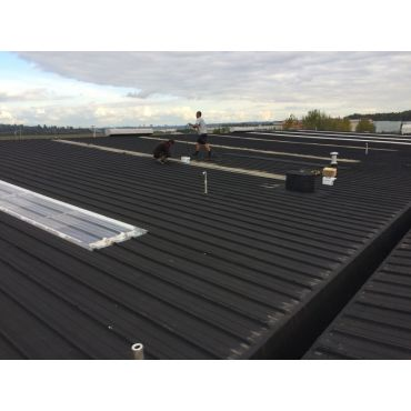 Canseal on a large Metal roof