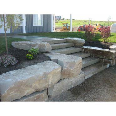 Landcape Design with stone garden beds