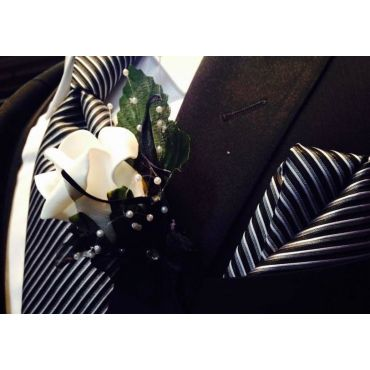 Black and white boutonniere