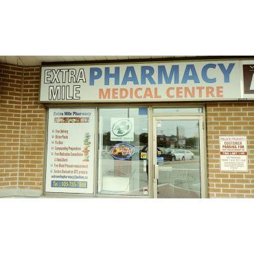 Extra Mile Pharmacy logo