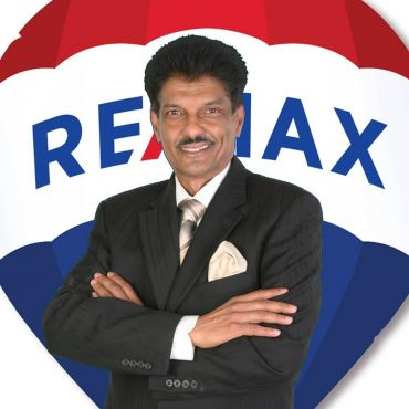 Harry Singh - Remax Realty Services PROFILE.logo