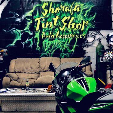 Shorafa Tint Shop & Auto Accessories PROFILE.logo