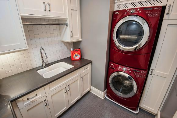 Gray Laundry Room Feels Young With Red Appliances