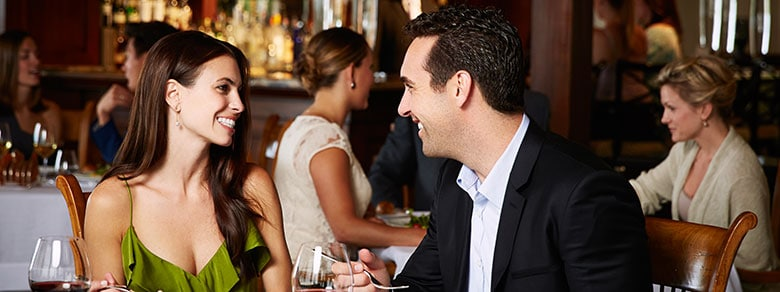 A Couple Enjoying a Meal at Studio Fine Dining Restaurant in Orange County