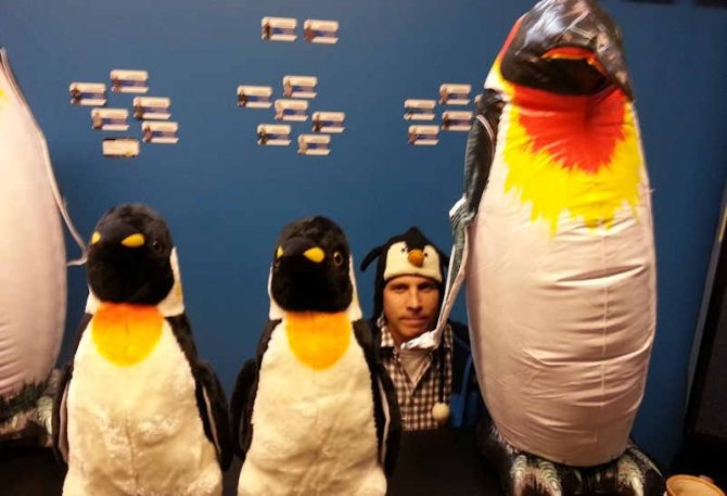VP and General Manager David Zelken attempts to fit in with some of the larger penguins...