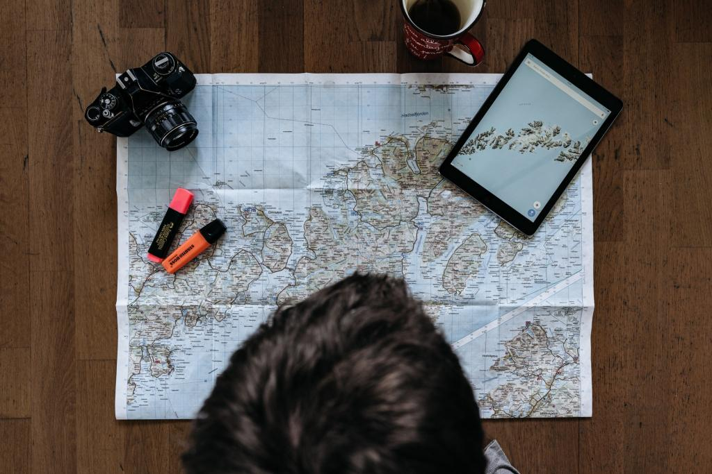teen traveller looking at maps with camera and highlighter