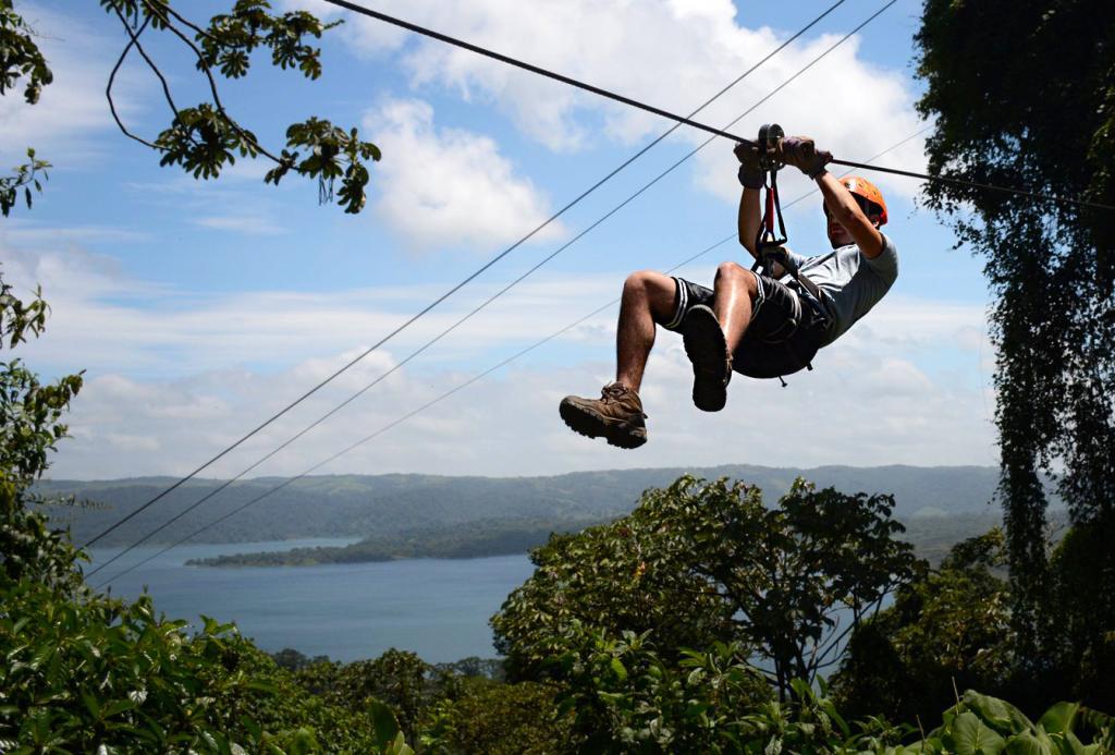 A teen zip-lines on a summer adventure tour of Costa Rica.