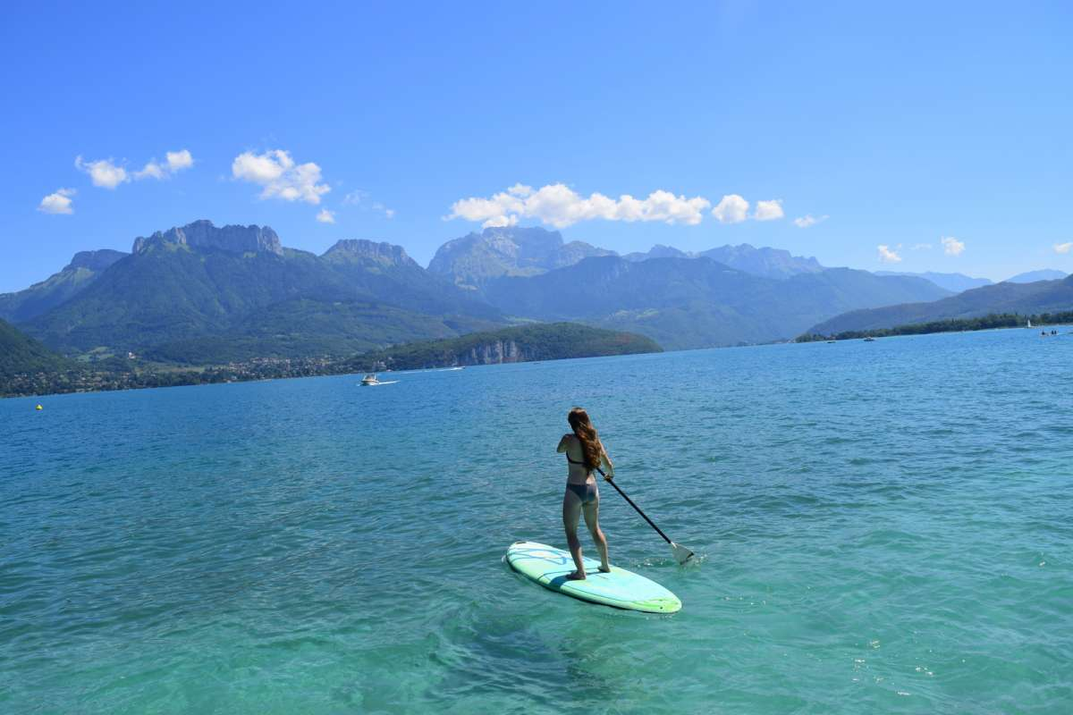 Teen does water sports in Europe on summer travel tour