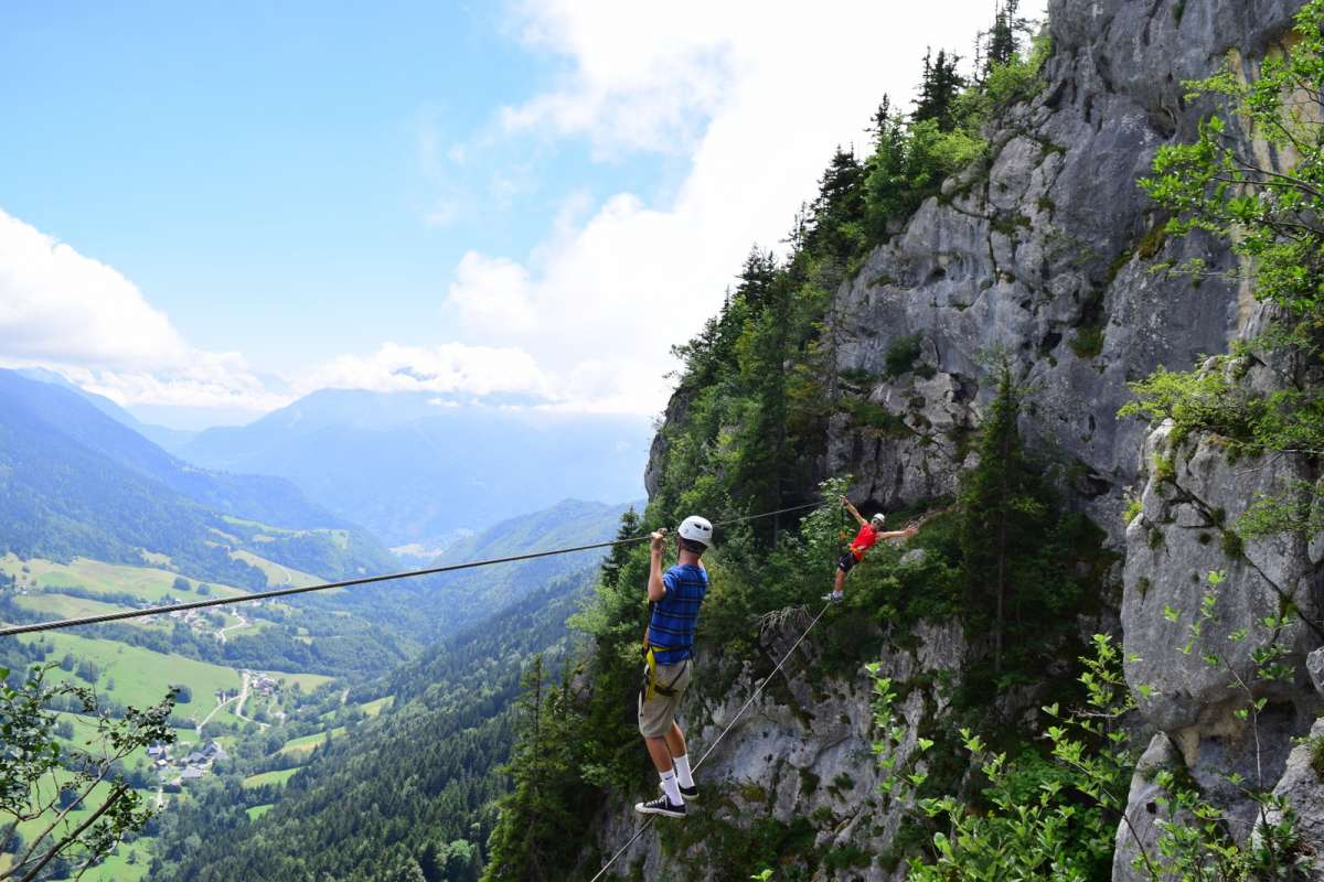 High school student doing adventure zipline in Europe on teen travel tour