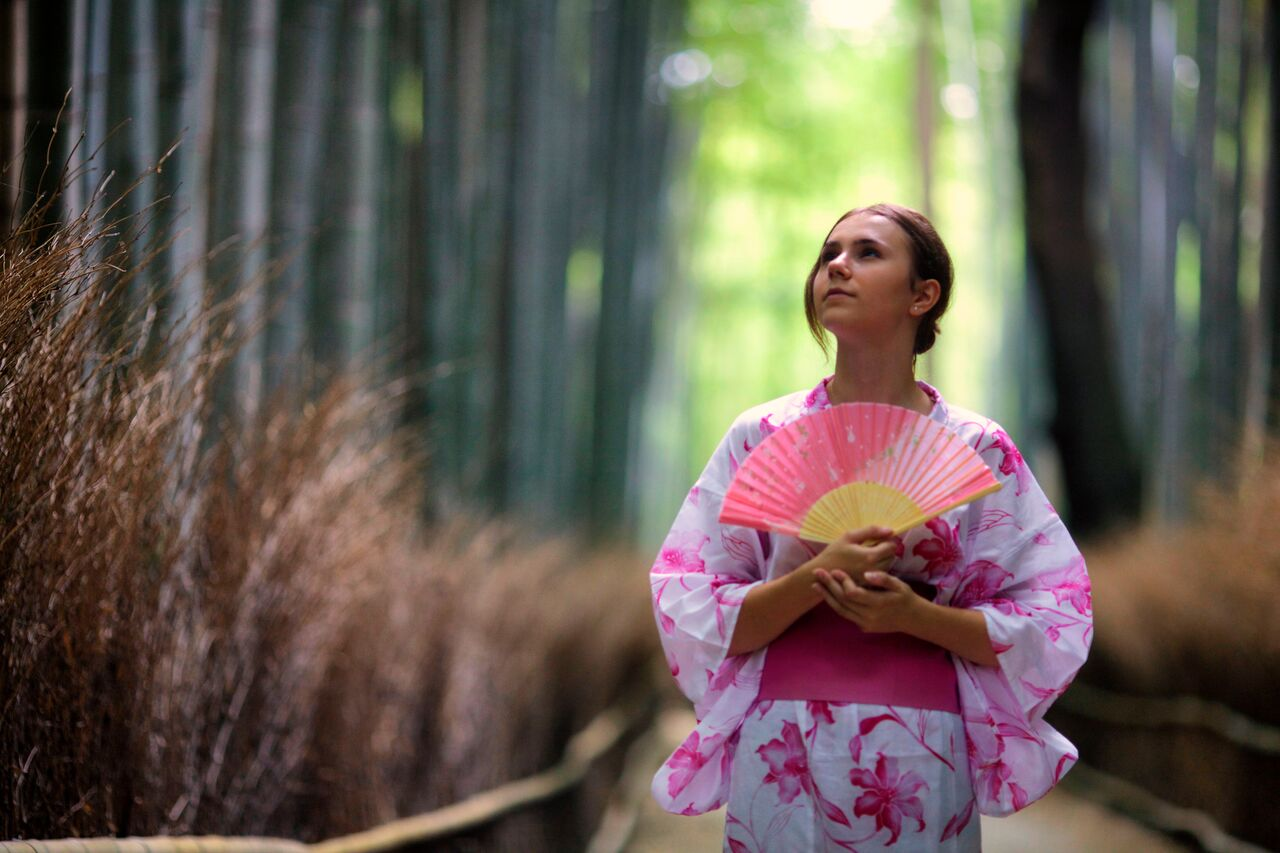 Teen poses in a traditional kimono on a high school program to Japan.