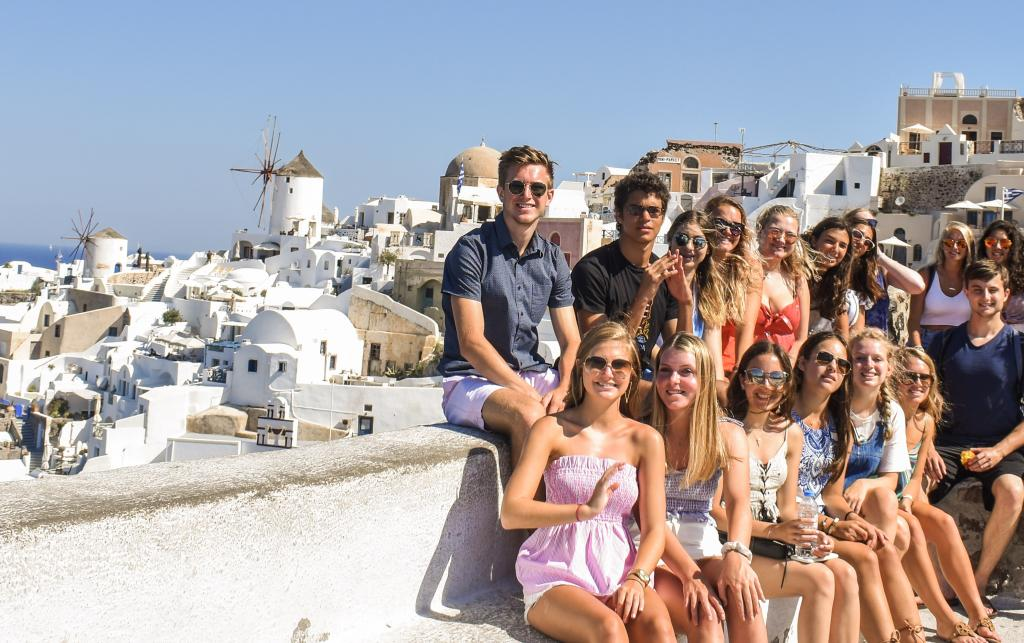 High school students smile in Santorini on their summer teen tour to Greece.