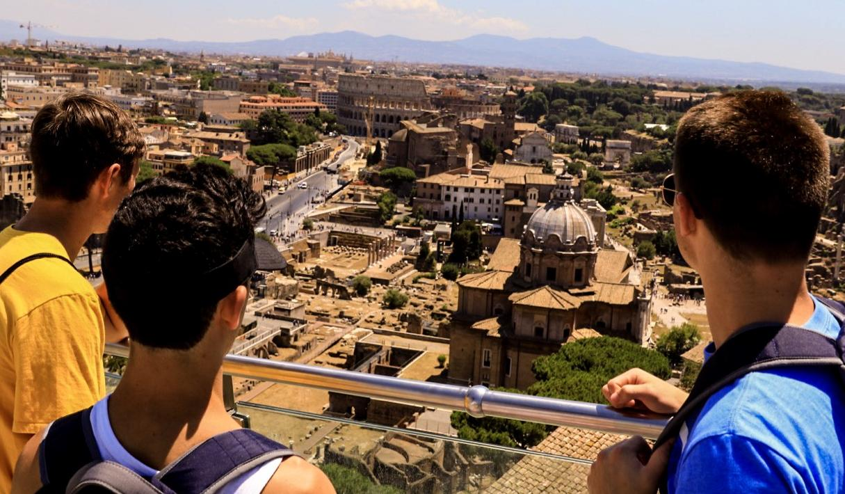 High school traveler takes in the ancient views in Rome on their summer tour to Italy.