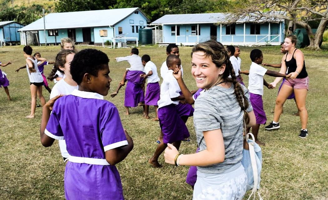 High school travelers engage with local communities in Fiji on their summer teen tour.