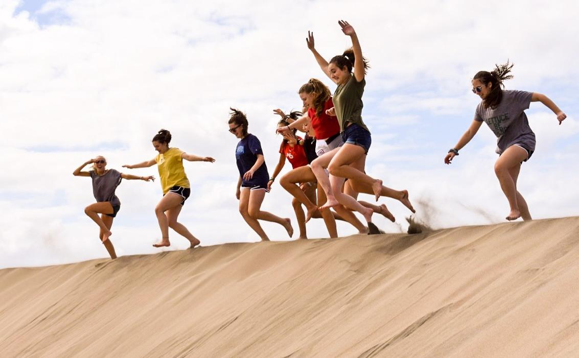 High school students adventure on sand dunes in Fiji during their summer program