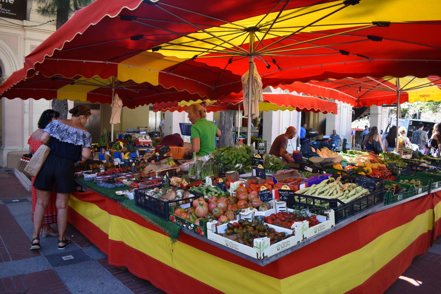 French produce market visited by teenage travelers on summer youth travel program