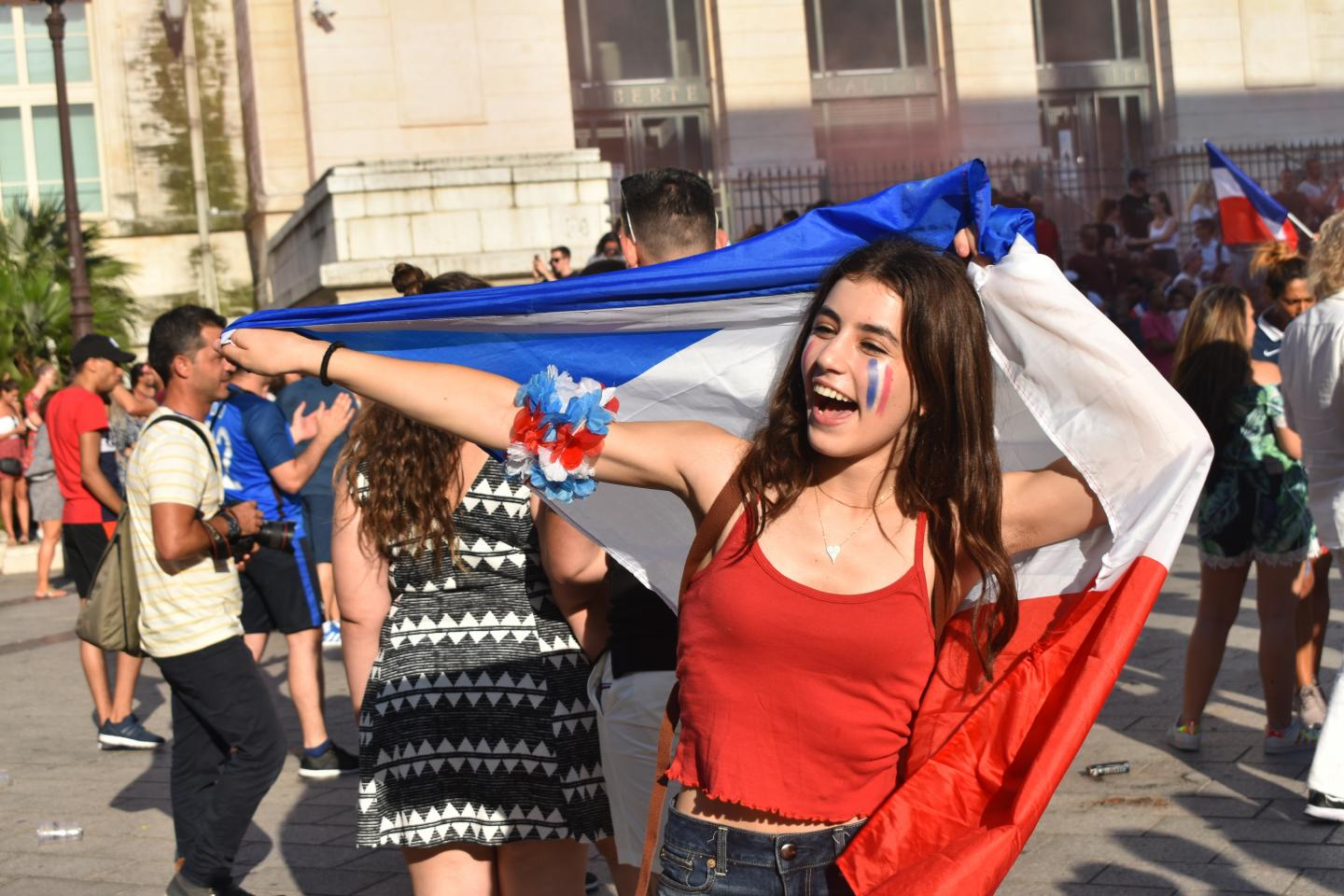 Teenage traveler celebrates Bastille Day in France during summer youth travel program