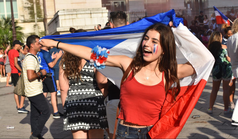 Teenage traveler celebrates Bastille Day in France during summer youth travel program