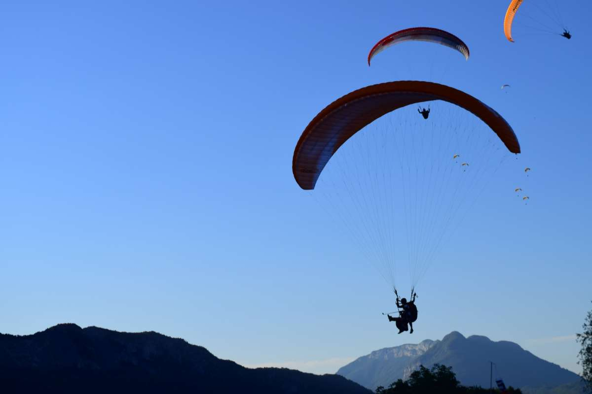 Teens paragliding in Europe on summer youth adventure program