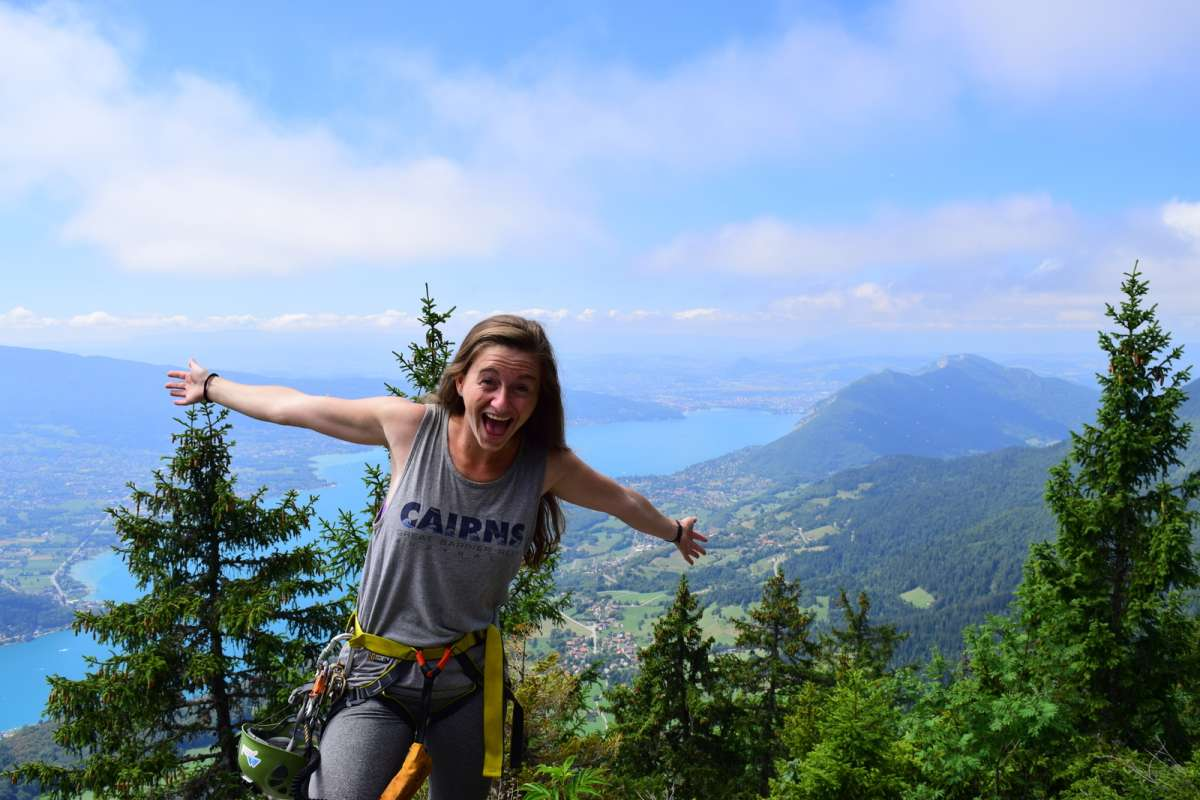 Happy teen overlooking wilderness on Alps adventure summer program