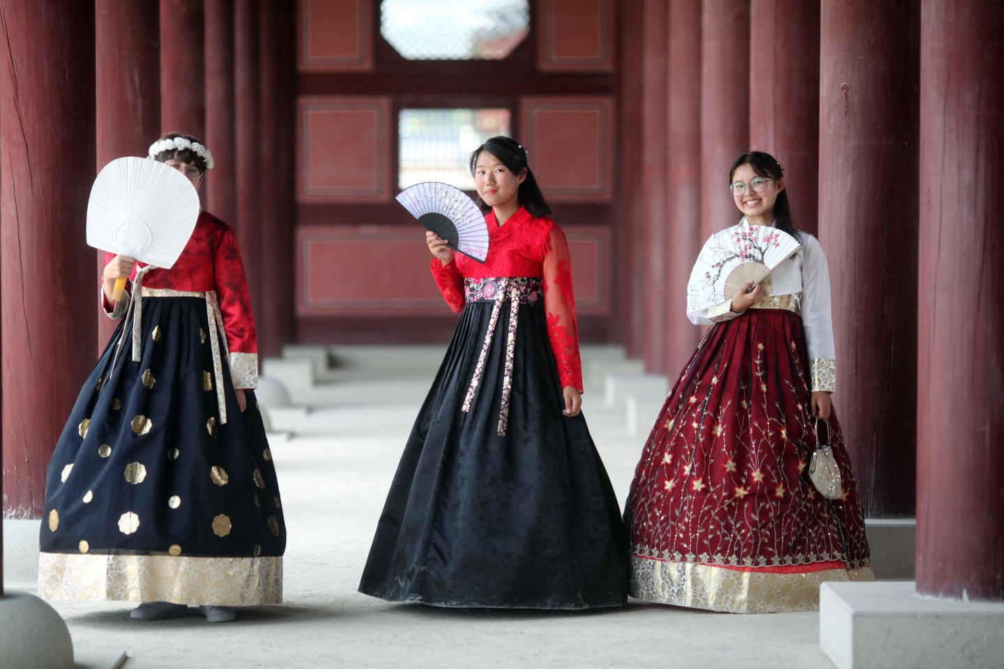 Teenage travelers wear hanbok at Palace in Seoul during summer youth travel program