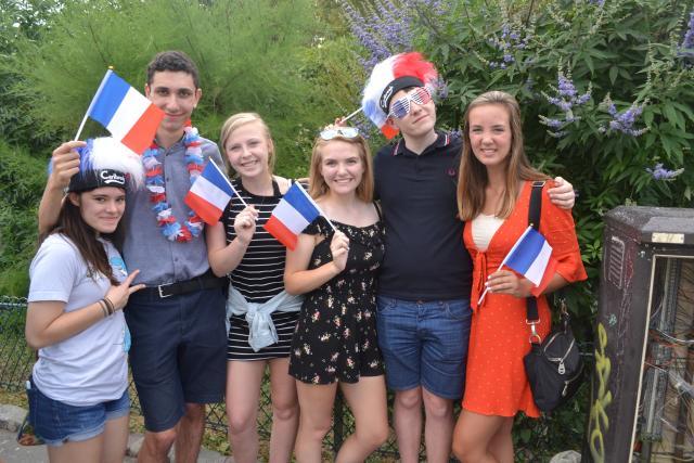 Teenage travelers celebrate Bastille Day in France on summer youth travel program