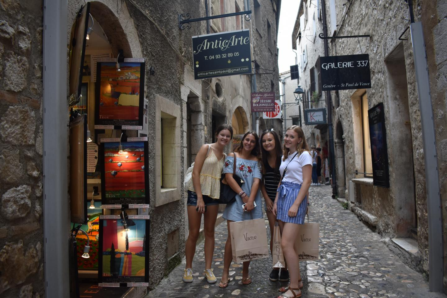 Teenage travelers shop in boutiques in French Riviera during summer youth travel program