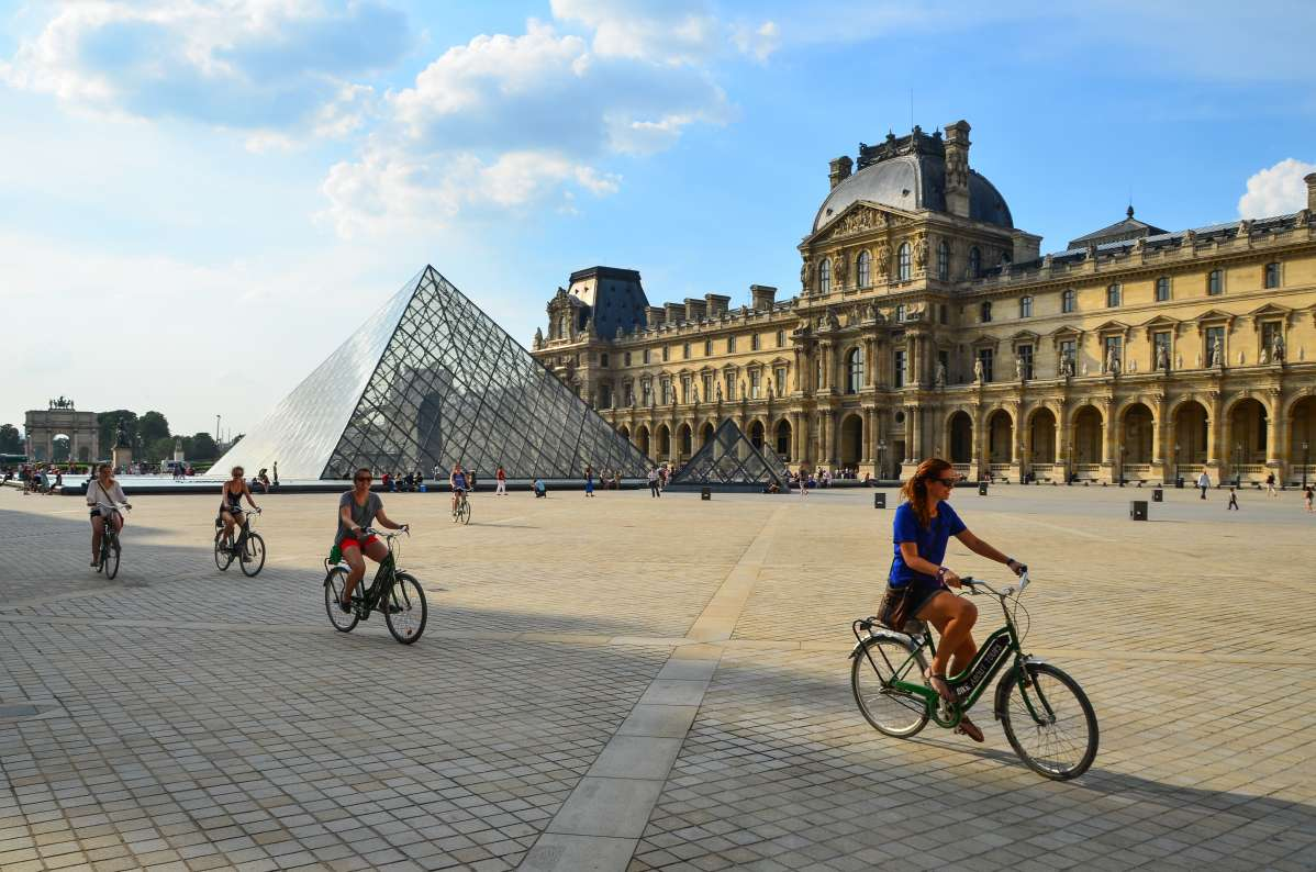 Teens bike through Louvre Museum on summer tour to France