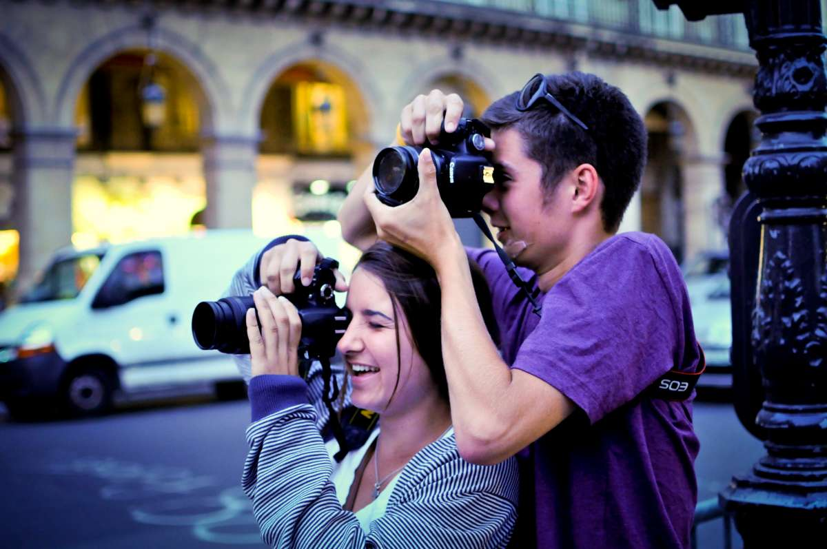 Teenage travelers learning photography in Paris France during summer program