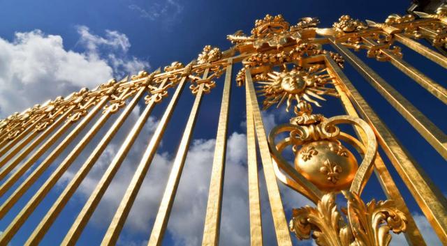 Golden gates of Chateau de Versailles seen on summer teen travel photography program