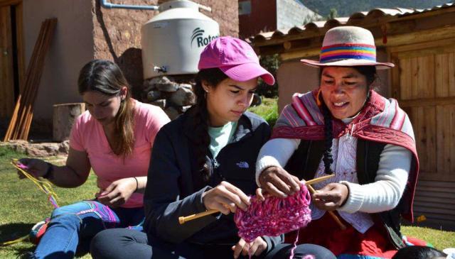 Teens work with locals on their summer community service program in Peru.