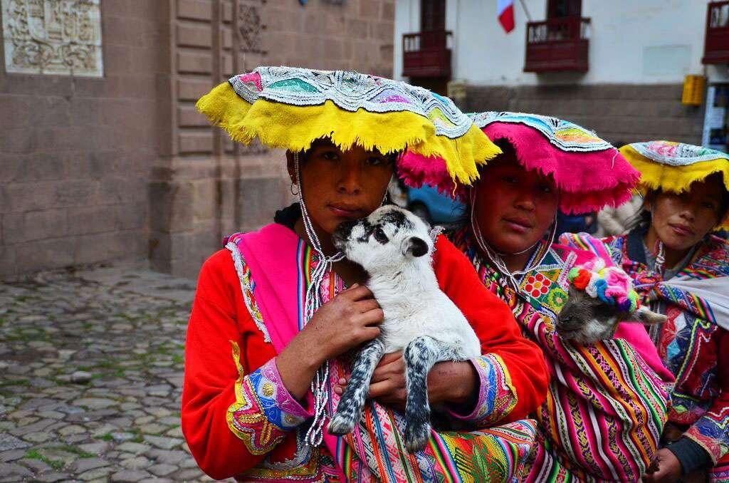 Local women pose for a photo taken by teens on their summer travel tour of Peru.