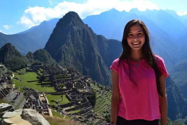 Teen enjoys Machu Picchu on her summer student tour of Peru.