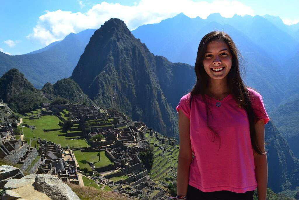 Teen enjoys Machu Picchu on her summer student tour of Peru.