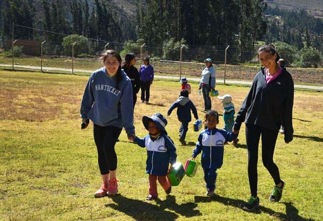 Teens play with local children on their summer service program in Peru.