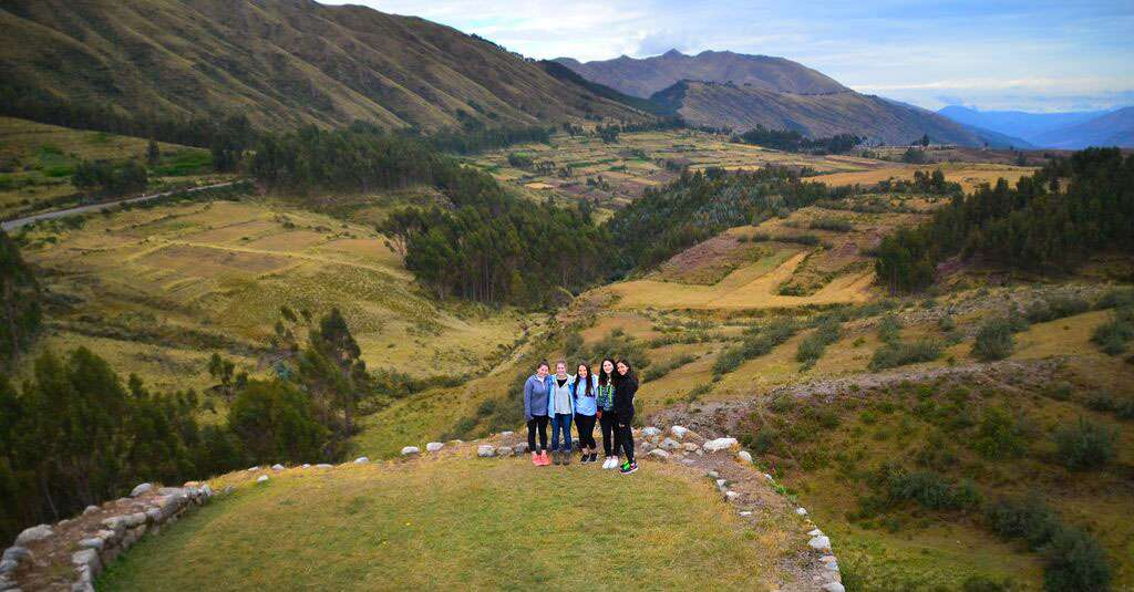 Students stand amongst the countryside of Peru on their summer teen travel tour.