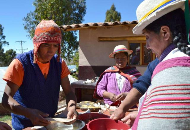 Students work with local people on their summer community service program in Peru.